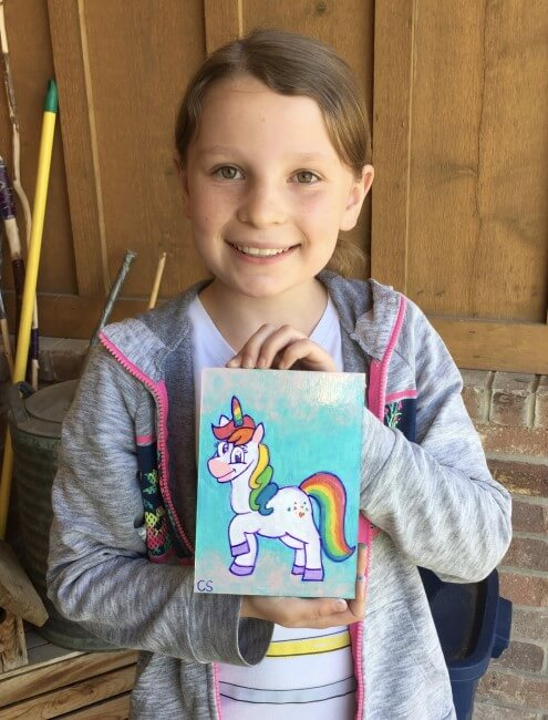 kid with unicorn painting